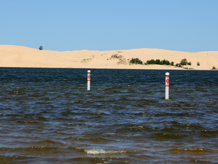 Awesome views of the Silver Lake Sand Dunes just across the lake from our private beach.