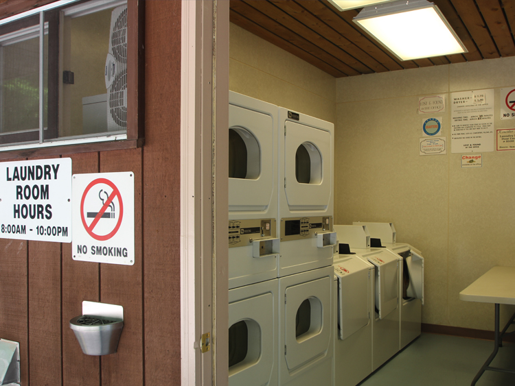 The laundry facility is conveniently located in the bathhouse building.